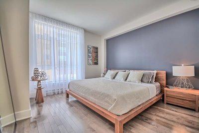 Chambre à coucher d'inspiration rustique aménagée par Signé Labelle
